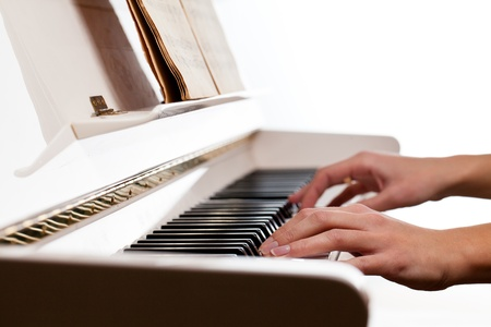 Playing Piano (shallow DOF; color toned image) photo