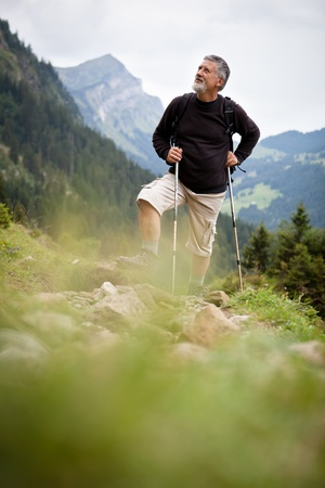 action fund: Active senior hiking in high mountains (Swiss Alps)