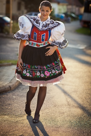 ceremonial: Keeping tradition alive: young woman in a richly decorated ceremonial folk dressregional costume (Kyjov folk costume, Southern Moravia, Czech Republic) Stock Photo