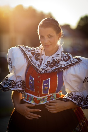 Keeping tradition alive: young woman in a richly decorated ceremonial folk dressregional costume (Kyjov folk costume, Southern Moravia, Czech Republic) Stock Photo