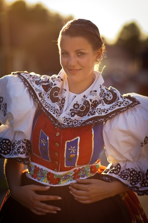 slavic: Keeping tradition alive: young woman in a richly decorated ceremonial folk dressregional costume (Kyjov folk costume, Southern Moravia, Czech Republic) Stock Photo