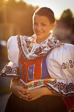 czech women: Keeping tradition alive: young woman in a richly decorated ceremonial folk dressregional costume (Kyjov folk costume, Southern Moravia, Czech Republic) Stock Photo