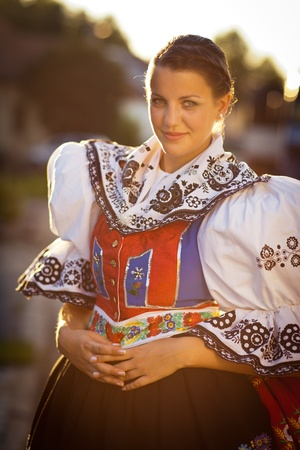 national costume: Keeping tradition alive  young woman in a richly decorated ceremonial folk dress regional costume  Kyjov folk costume, Southern Moravia, Czech Republic  Stock Photo