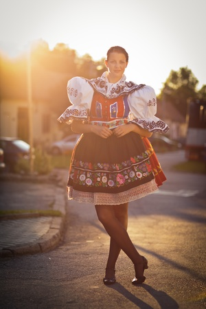 europe eastern: Keeping tradition alive: young woman in a richly decorated ceremonial folk dressregional costume (Kyjov folk costume, Southern Moravia, Czech Republic) Stock Photo