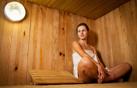 finnish bath: Young woman relaxing in a sauna