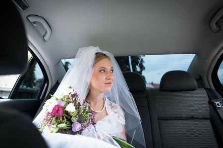 Portrait of a beautiful young bride waiting in the car on her way to the wedding ceremony Stock Photo - 12808417