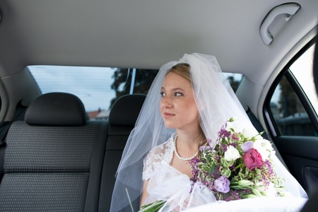 Portrait of a beautiful young bride waiting in the car on her way to the wedding ceremony Stock Photo - 12808401