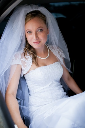Portrait of a beautiful young bride waiting in the car on her way to the wedding ceremony Stock Photo - 12808407