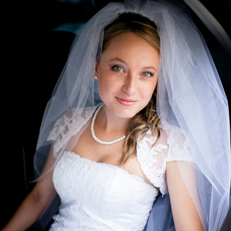 Portrait of a beautiful young bride waiting in the car on her way to the wedding ceremony Stock Photo - 12808362