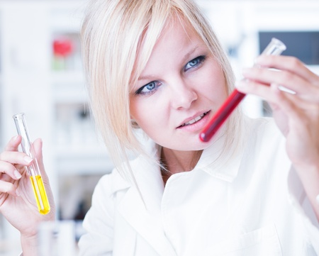 portrait of a female researcher/chemistry student carrying out research in a lab Stock Photo - 12808404