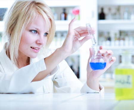 portrait of a female researcherchemistry student carrying out research in a lab photo