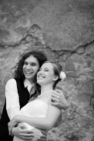 Black and white portrait of a young wedding couple with copy space photo