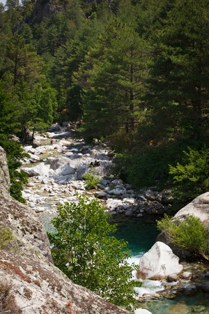 Inland Corsica, splendid Restonica Valley - with natural pools on the river and exquisite mountains photo
