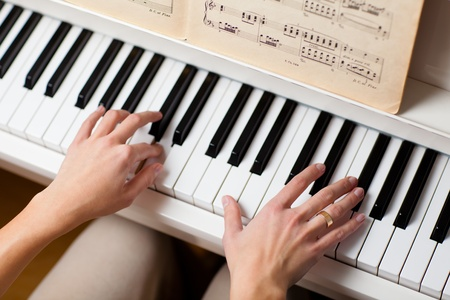 playing music: Playing Piano (shallow DOF; color toned image)