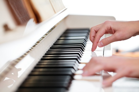 side keys: Playing Piano (shallow DOF; color toned image)
