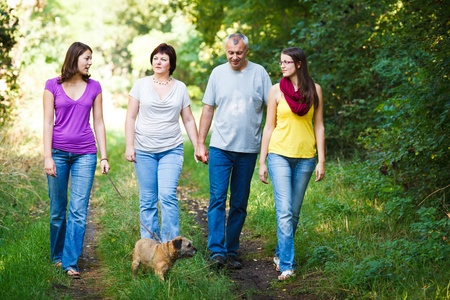 Family portrait - Family of four with a cute dog outdoors photo