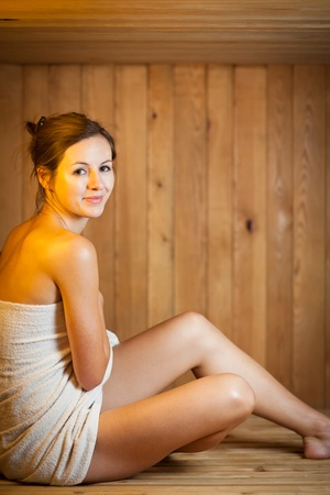 Young woman relaxing in a sauna Stock Photo - 12987870