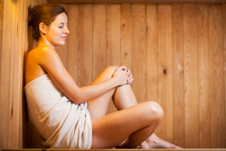 steam: Young woman relaxing in a sauna