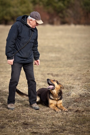 alsation: Master and his obedient  German Shepherd  dog Stock Photo
