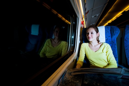 Young woman traveling by train at night photo