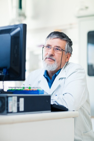 Senior researcher using a computer in the lab while working on an experiment  color toned image Stock Photo - 13531690