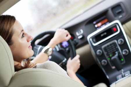 transport interior: woman driving a car