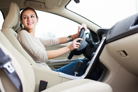 new automobiles: woman driving a car