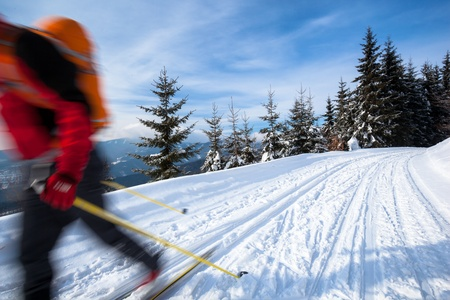 Cross-country skiing: young man cross-country skiing on a lovely sunny winter day Stock Photo - 13445470