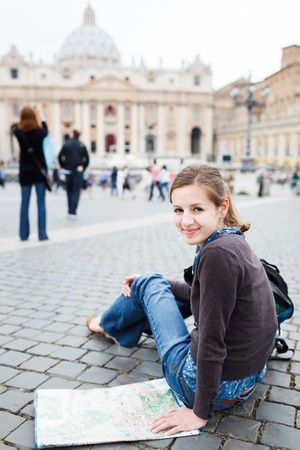 st  peter s square: Pretty young female tourist studying a map at St  Peter