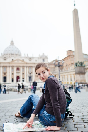 st  peter's basilica pope: Pretty young female tourist studying a map at St  Peter