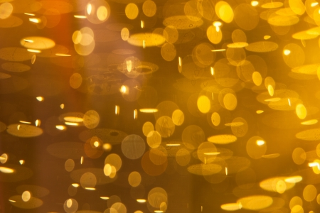 Golden macro background: gas bubbles in beer at shallow DOF against sunlight Stock Photo - 13926273