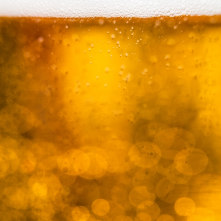Golden macro background: gas bubbles in beer at shallow DOF against sunlight Stock Photo - 13933333