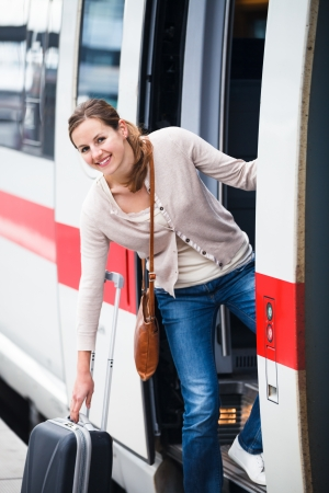 Pretty young woman boarding a train  Stock Photo - 14197050