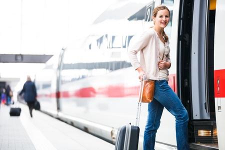 intercity: Pretty young woman boarding a train