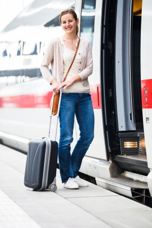 intercity: Pretty young woman boarding a train (color toned image) Stock Photo