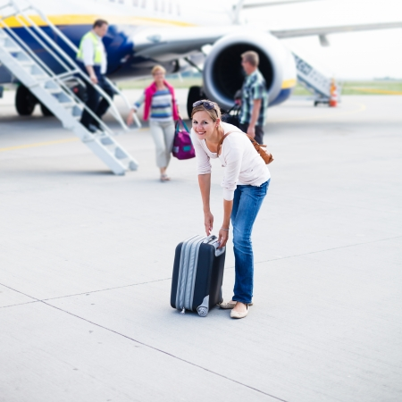 just arrived: Just arrived: young woman at an airport having just left the aircraft