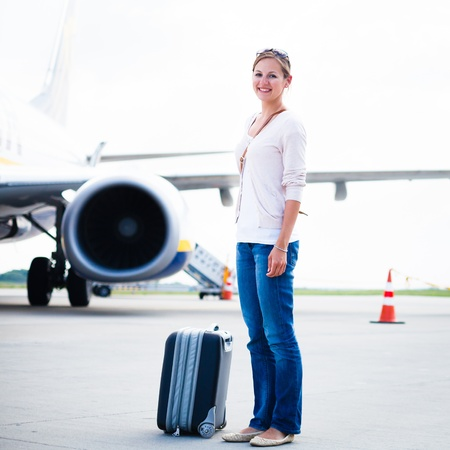 arrived: Just arrived: young woman at an airport having just left the aircraft