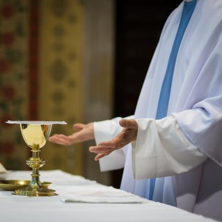catholic wedding: Priest during a wedding ceremonynuptial mass