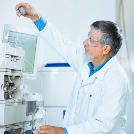 Senior male researcher carrying out scientific research in a lab (shallow DOF; color toned image) Stock Photo - 15284351