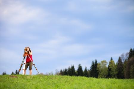 work station: Young land surveyor at work