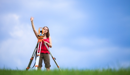 leveling instrument: Young land surveyor at work