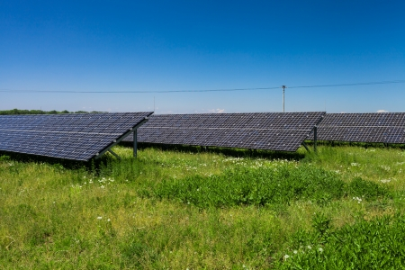 Sunlight as a resource of renewable energy: solar panels on a sunny day photo