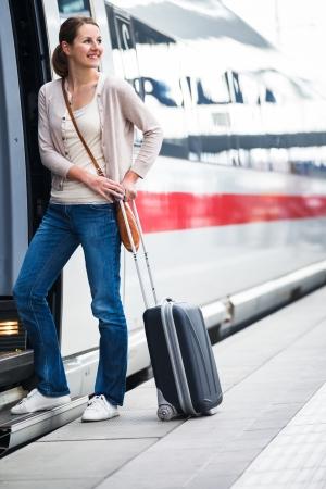 intercity: Pretty young woman boarding a train Stock Photo