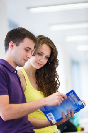 higher education: Two college students in library