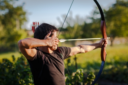 Robin: Young archer training with the  bow