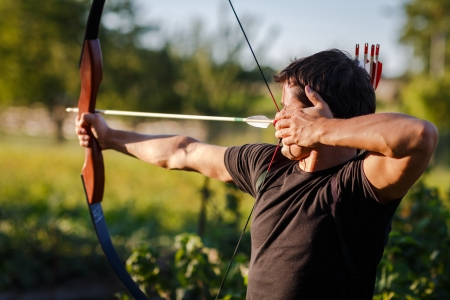 Young archer training with the  bow photo