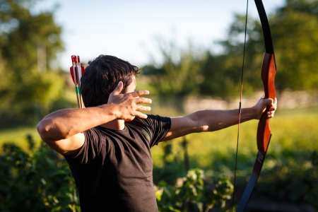 target practice: Young archer training with the  bow