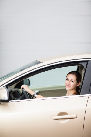 Pretty young woman driving her new car Stock Photo - 15284695
