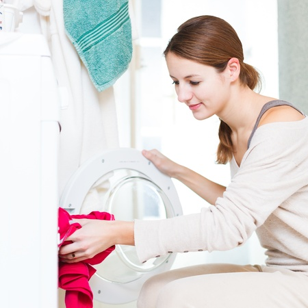 Housework: young woman doing laundry photo