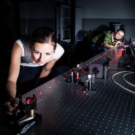 quantum physics: Female scientist doing research in a quantum optics lab Stock Photo